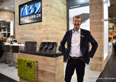 "Erwin Verbraeken of Bachmann promoting the fact that their tray are 100% recyclable and 100% recycled. ""Our trays always had these characteristics, but as it is such a hot topic, we show also at the show."""