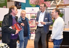 Maurice van der Meer and Olaf van der Voort (at the right ) in conversation with a client.